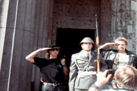 The scorpions: The lead singer and guitarist for the band The Scorpions, photographed here at a Changing Of The Guard ceremony taking place in East Berlin. Apparently these guards are similar to the famous ones in England who are not allowed to move while on duty. The rockers were traveling with Tom's tour group of East Berlin and decided this would be a great photo op. It sure was!
