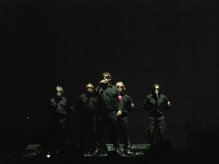 The Male Chorus with Robbie Wyckoff onstage in Chicago, IL (photo by Robert Perry)