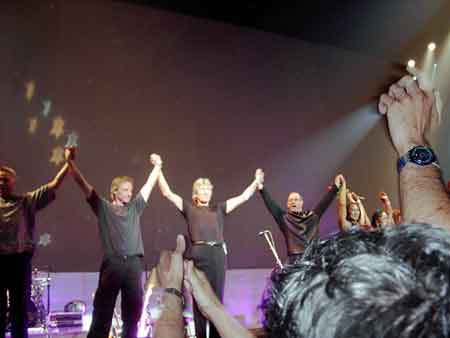 Check out this almost evangelical picture! The light seems to be emanating from the upraised hand and shining on Roger!