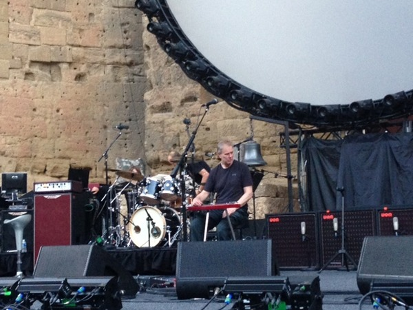Phil Taylor (David's guitar tech) checks the equipment before the show gets underway