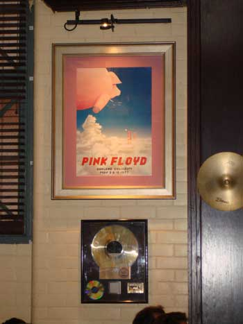 We reckon that the Hard Rock would close down if it wasn't for the patronage of DMFLOYD. This time he visted the Hard Rock in Baltimore, Maryland (Sep 07) and spotted the famous Oakland poster. He said the award below the poster is forThe Wall but it has been modified and the album cover has faded.